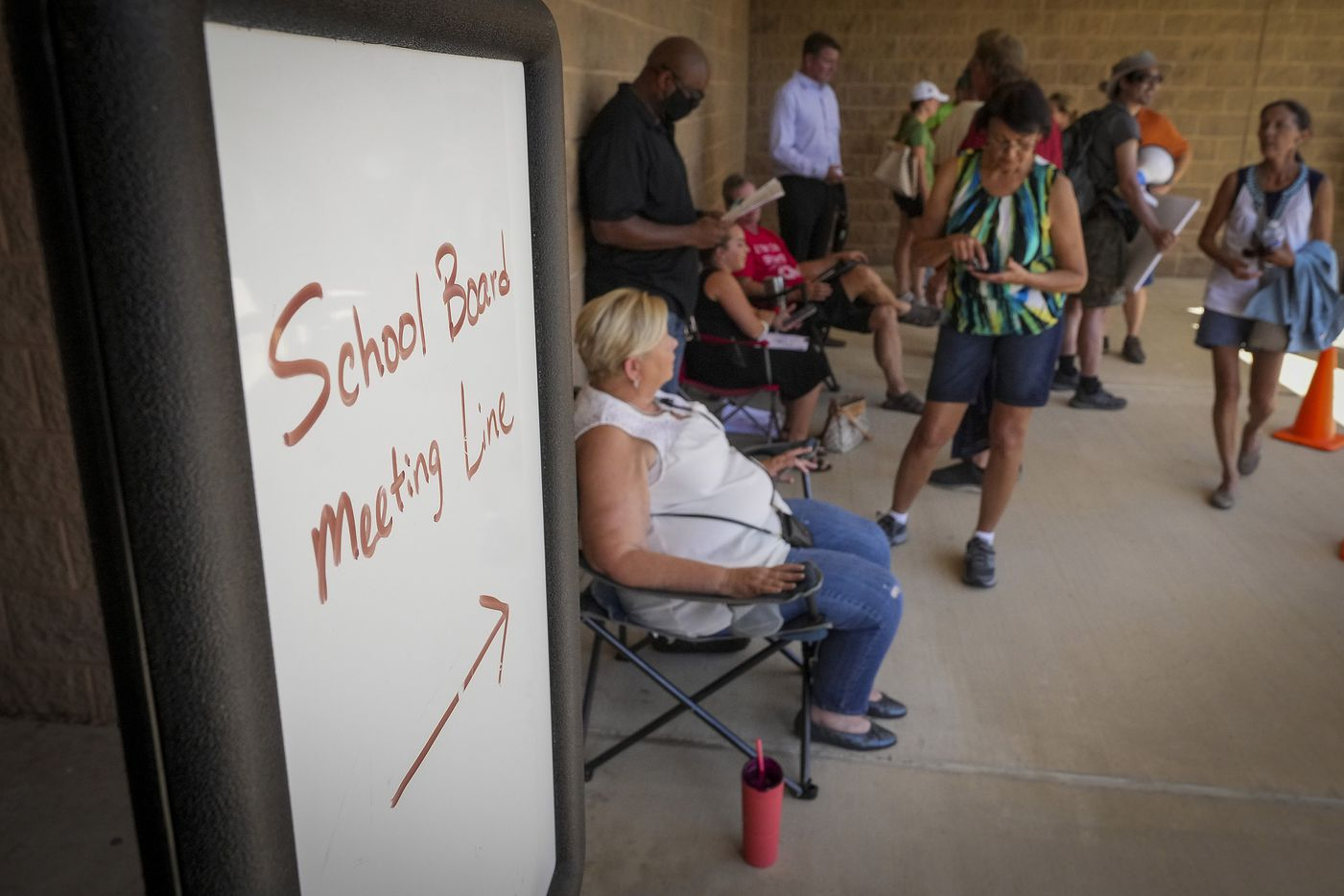 People wait in line to enter the Carroll ISD school board meeting on Monday, Aug. 23, 2021, in Southlake, Texas. (Smiley N. Pool/The Dallas Morning News)
