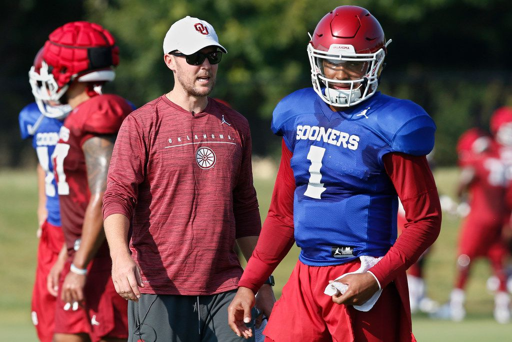 FILE - In this Monday, Aug. 5, 2019, file photo, Oklahoma head coach Lincoln Riley watches quarterback Jalen Hurts (1) during the NCAA college football team's practice in Norman, Okla. Riley has chosen Hurts as his starting quarterback for the Sept. 1 season opener against Houston over Spencer Rattler and Tanner Mordecai. (AP Photo/Sue Ogrocki, File)