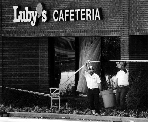 Workers remove debris from the scene of the Luby's massacre in 1991.