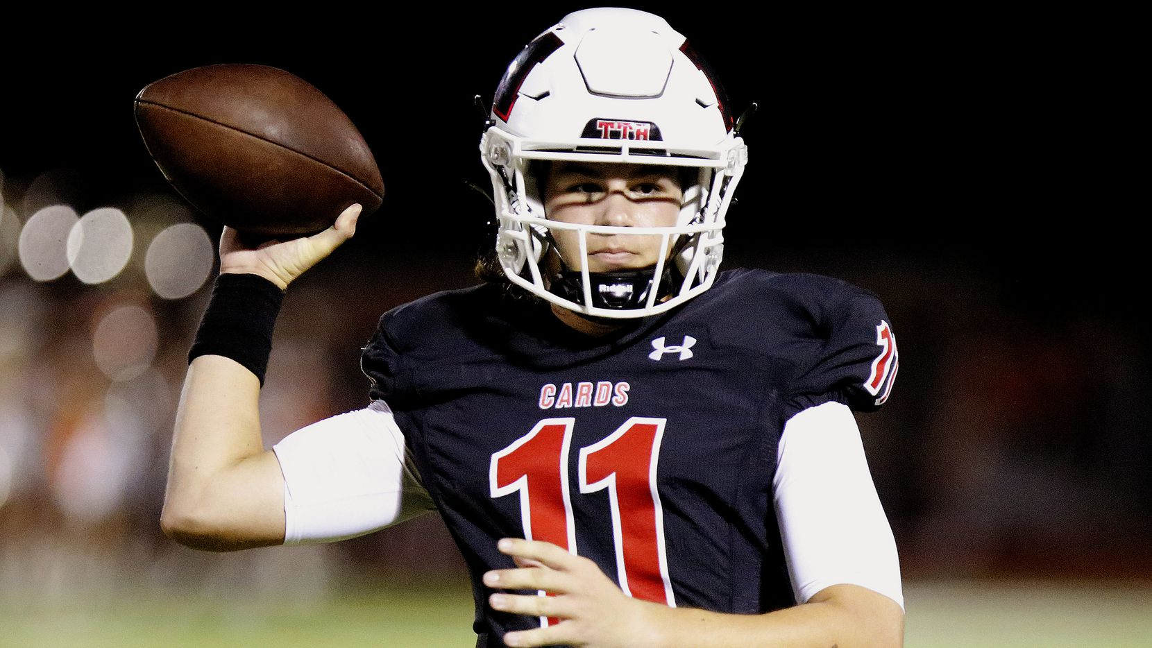 Melissa High School quarterback Sam Fennegan (11) throws a pass during the first half as Melissa High School hosted Celina High School at Cardinal Field in Melissa on Friday night, August 27, 2021.