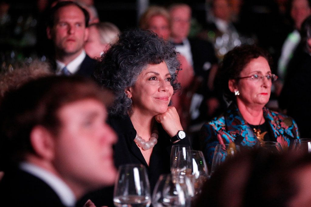 Doris Salcedo, the first recipient of the Nasher Prize, watches a short film about this years winner, French artist Pierre Huyghe, during a gala at the Nasher Sculpture Center in Dallas, Saturday, April 1, 2017. (Tom Fox/The Dallas Morning News)