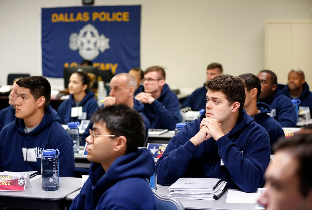 Recruits in Dallas Police Class 365 listen to a lesson about financial peace at the Dallas Police Academy in Dallas.