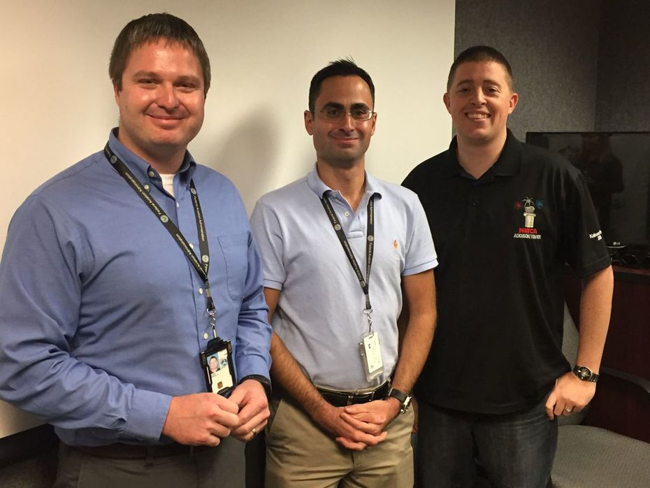 Air traffic controllers Josh Kovar (left) and Marc Gough (right) helped resolve the crisis that developed for a Cessna just after it left the runway. FAA inspector Cristóbal Diaz (center) was aboard the flight, overseeing an instructor certification check ride by a student pilot. The photo was taken during a later event at Addison Airport to recognize the controllers for their quick thinking in the moment of danger. (FAA)