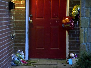 Flowers, balloons and cards have been placed outside of a home where 1-year-old boy Rory Norman was killed and his uncle was shot inside a home early Sunday morning on Valentine Street in South Dallas, Jan. 5, 2020.