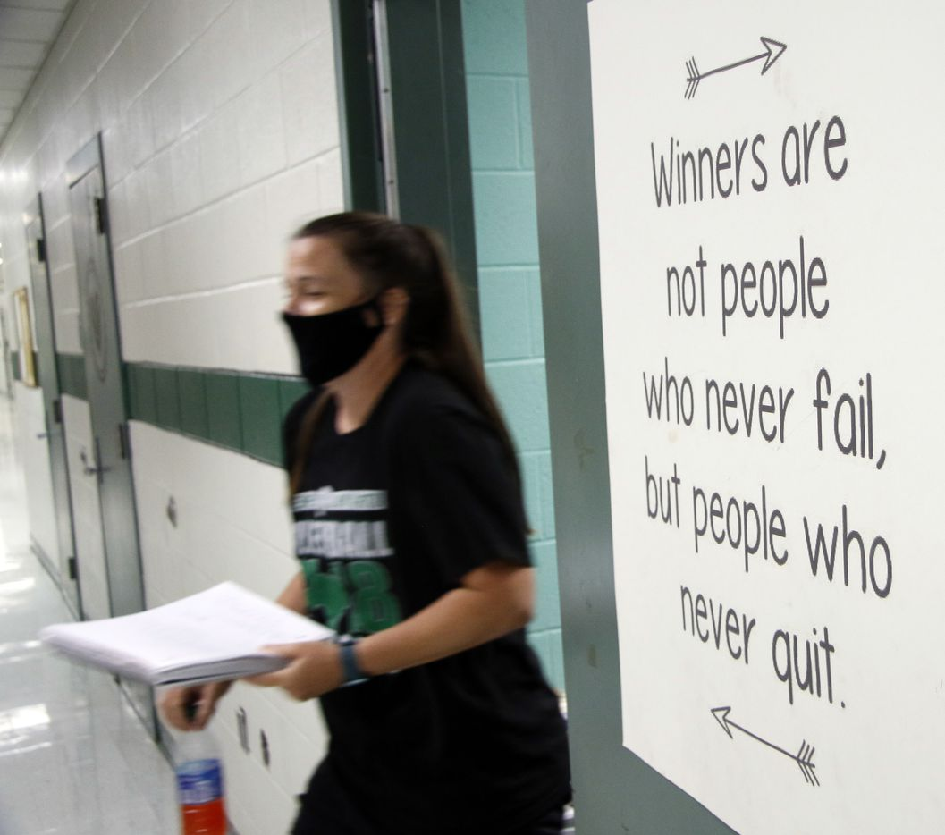 Kennedale head coach Kelly Carl walks from her office past a motivational message in preparation for her volleyball team practice session.Under the direction of  Carl, the Lady Kats conducted their first practice of the season at Kennedale High School in Kennedale on August 03, 2020.(Steve Hamm/ Special Contributor)