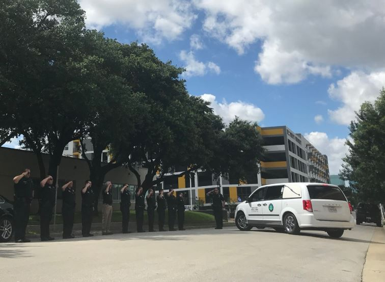 Police formed a procession to carry the body of Officer A.J. Castaneda from Medical City Arlington to the Tarrant County medical examiner's office in Fort Worth.