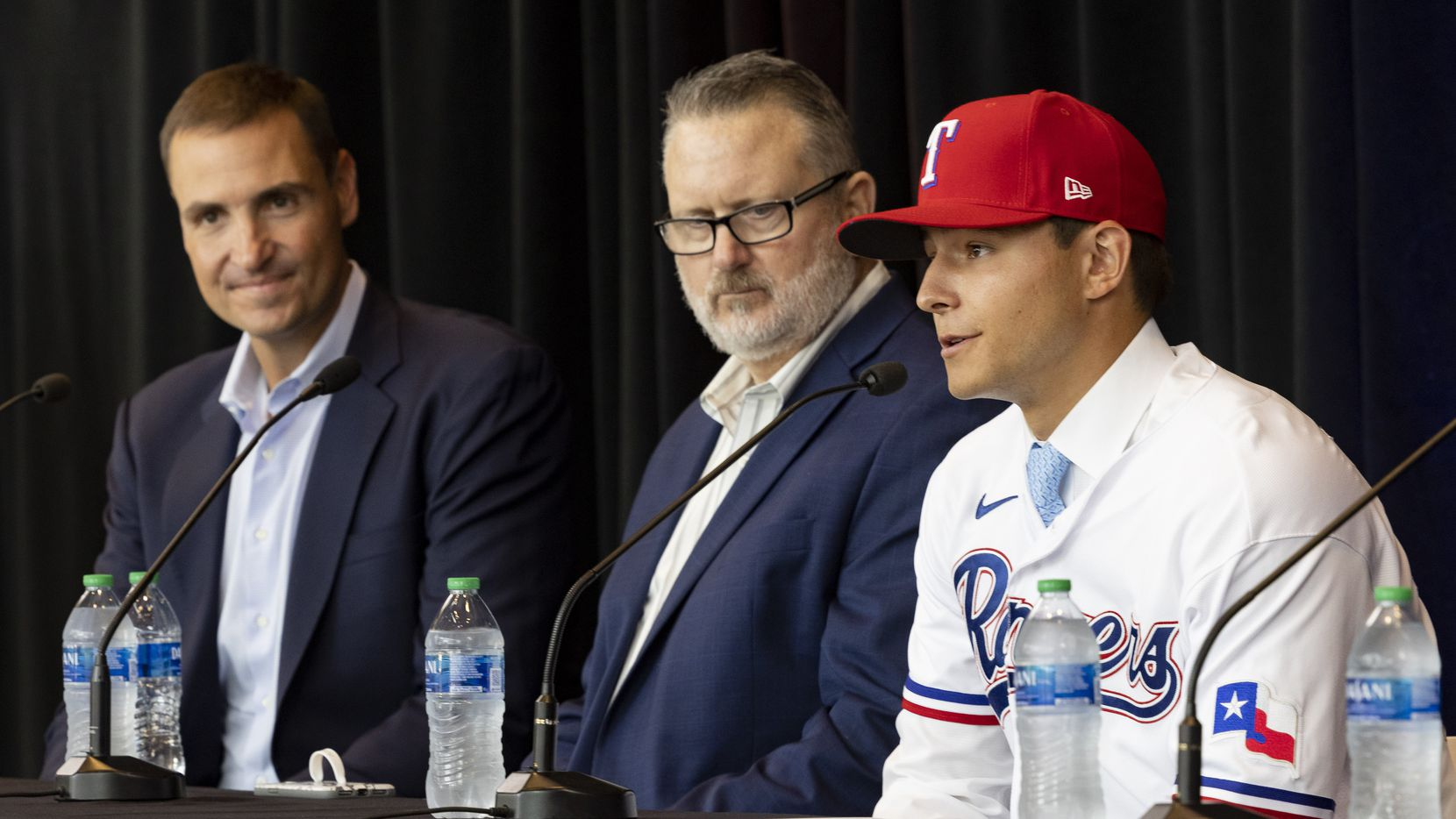 (From left) Chris Young, Texas Rangers Executive Vice President and General Manager, Kip Fagg, Rangers Senior Director of Amateur Scouting, listen to Jack Leiter from Vanderbilt University speak during a press conference announcing his signing on Tuesday, July 27, 2021, at Globe Life Field in Arlington. Leiter was the club's 2021 MLB Draft first round selection and the draft's second overall pick. (Juan Figueroa/The Dallas Morning News)