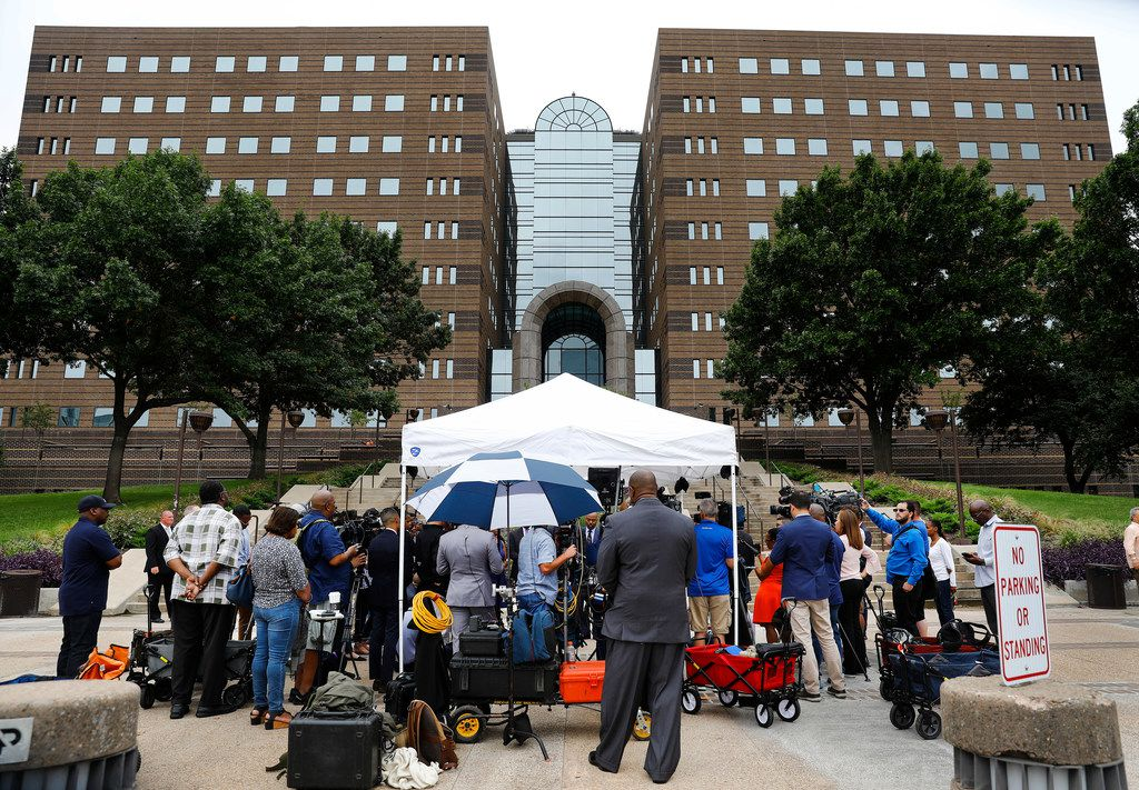 The Jean family and their attorneys held a press conference in front of the Frank Crowley Courts Building in Dallas on Monday.
