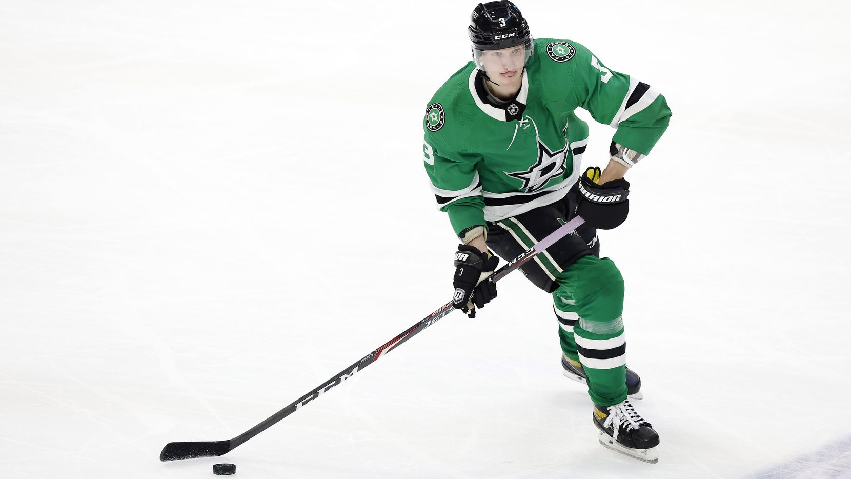 Dallas Stars defenseman John Klingberg (3) controls the puck at mid-ice the Stars play the Columbus Blue Jackets in the second period at the American Airlines Center in Dallas, Thursday, March 4, 2021.