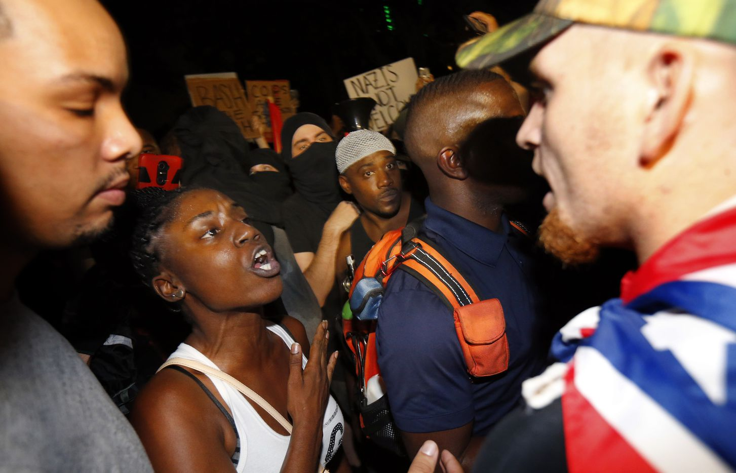 Protestors clash in Pioneer Park following the March Against White Supremacy.