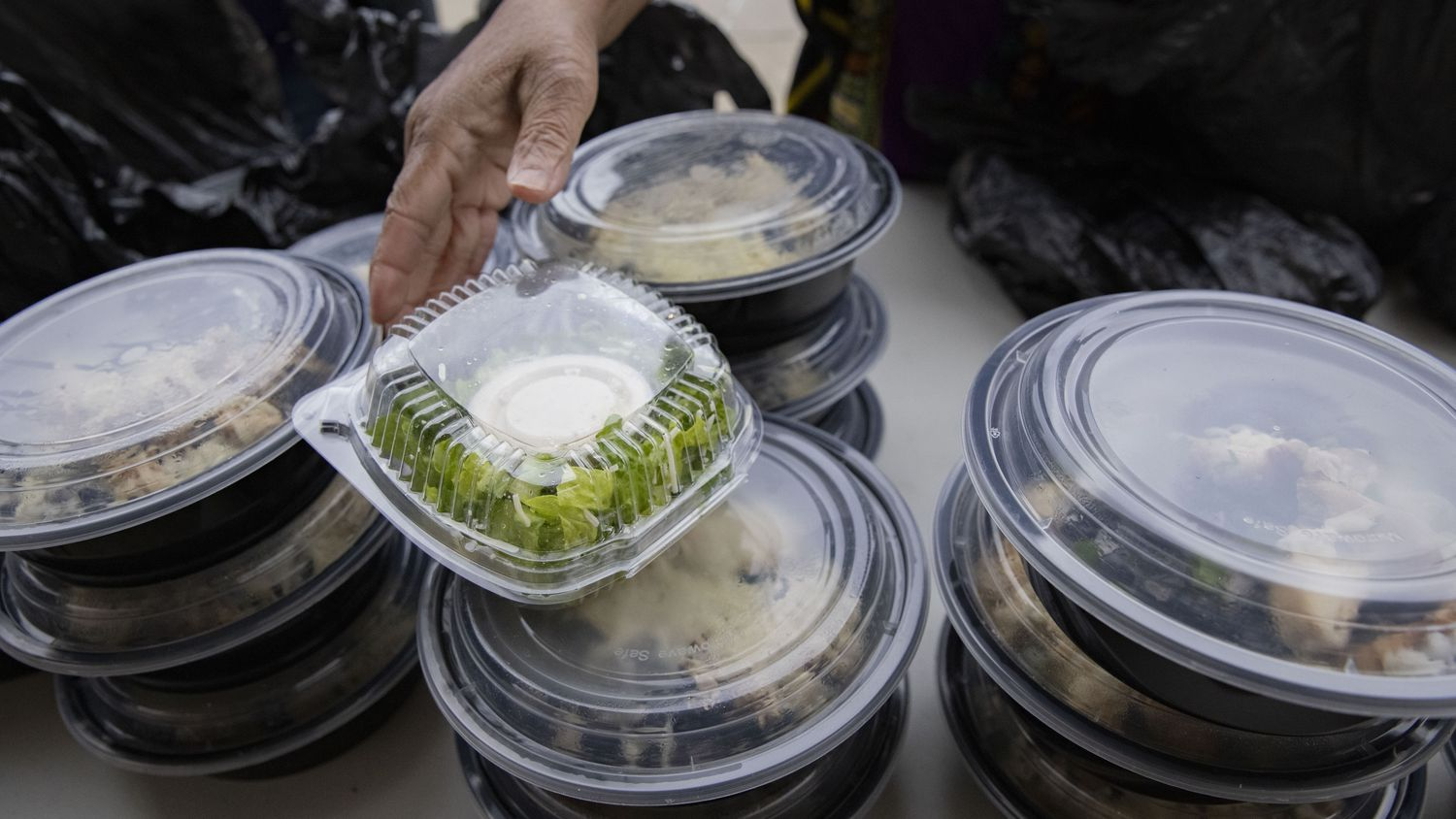 DFW's Hindu community has provided 5,000 meals, including pizzas and sandwiches, to people without food and water in Dallas.