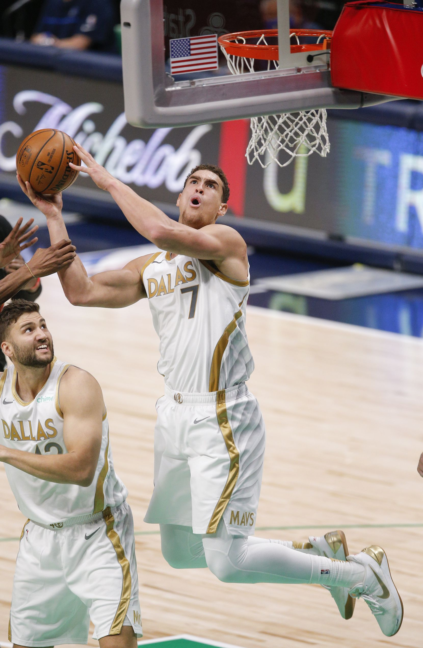 Dallas Mavericks forward Dwight Powell (7) attempts a shot during the first half of an NBA basketball game against the Miami Heat, Friday, January 1, 2021. (Brandon Wade/Special Contributor)