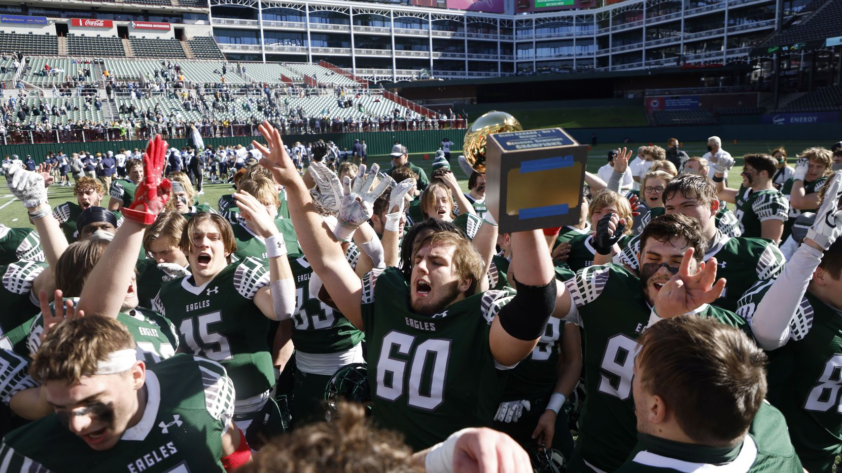 Prosper's Nash Gagliano (60) holds the semifinal trophy after they defeated Northwest Eaton 27-17 during the Class 6A Division II Region I semifinal high school football playoff game on Dec. 26, 2020. (Michael Ainsworth/Special Contributor)