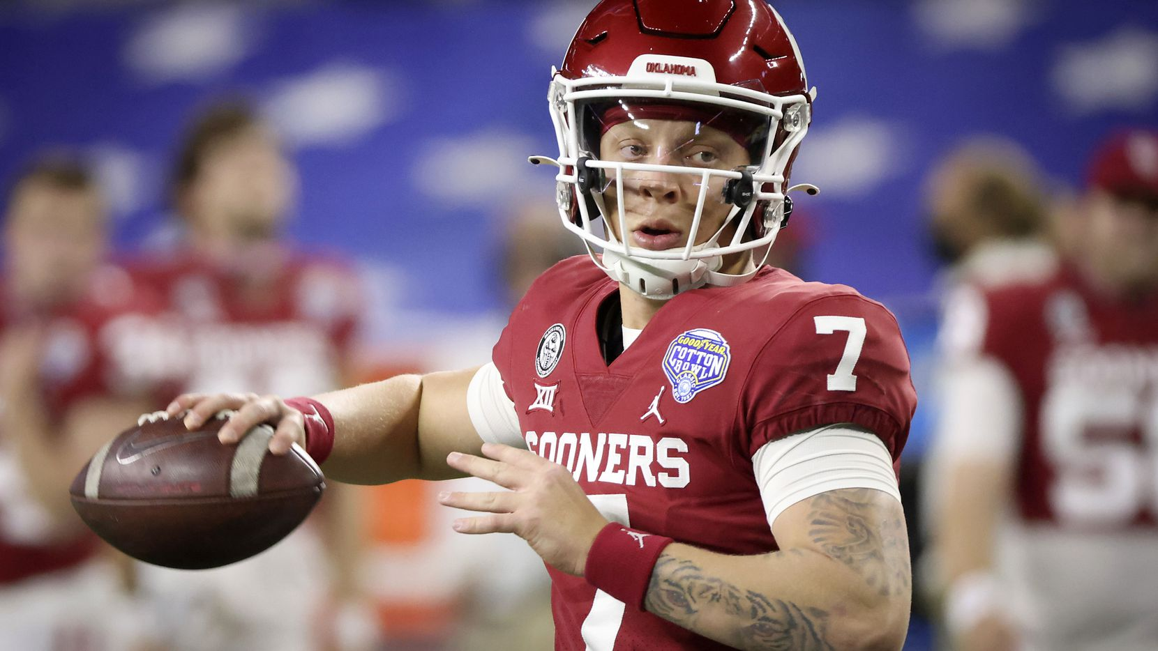 Oklahoma quarterback Spencer Rattler (7) warms up before the Cotton Bowl Classic against Florida at AT&T Stadium on Wednesday, Dec. 30, 2020, in Arlington.