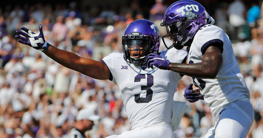TCU Horned Frogs wide receiver Shaun Nixon (3) leaps in the air with wide receiver Jalen Reagor (18) after Nixon's second quarter touchdown as SMU plays TCU in their annual Iron Skillet game in Fort Worth, Saturday, September 16, 2017. ORG XMIT: B7310934504Z.1