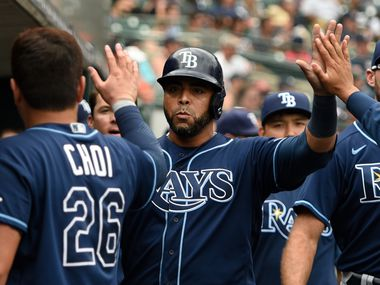 Tampa Bay Rays designated hitter Nelson Cruz, center, is congratulated by teammates after scoring a run on a ground out by Kevin Kiermaier off Detroit Tigers relief pitcher Gregory Soto in the tenth inning of a baseball game, Sunday, Sept. 12, 2021, in Detroit.