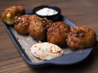 East Texas Hush Puppies with charred okra, pimento cheese and cajun remoulade sauce, from Elm&Good restaurant inside the Kimpton Pittman Hotel in Deep Ellum.