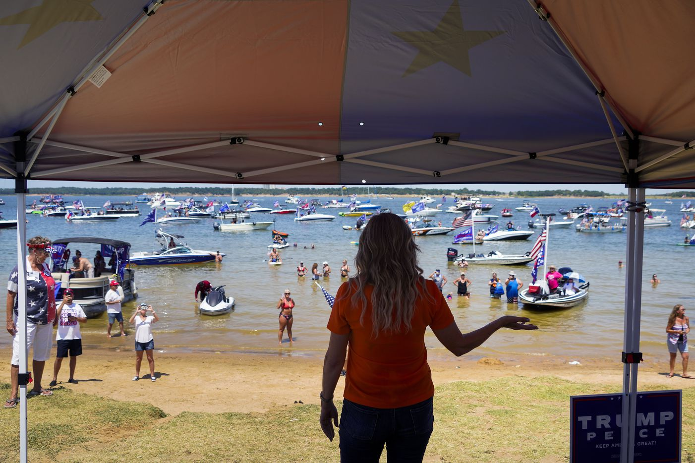 Shelley Luther, owner of Salon ‡ la Mode,  addresses supporters of President Donald Trump during a campaign rally and boat parade at Oak Grove Park on Grapevine Lake on Saturday, Aug. 15, 2020.