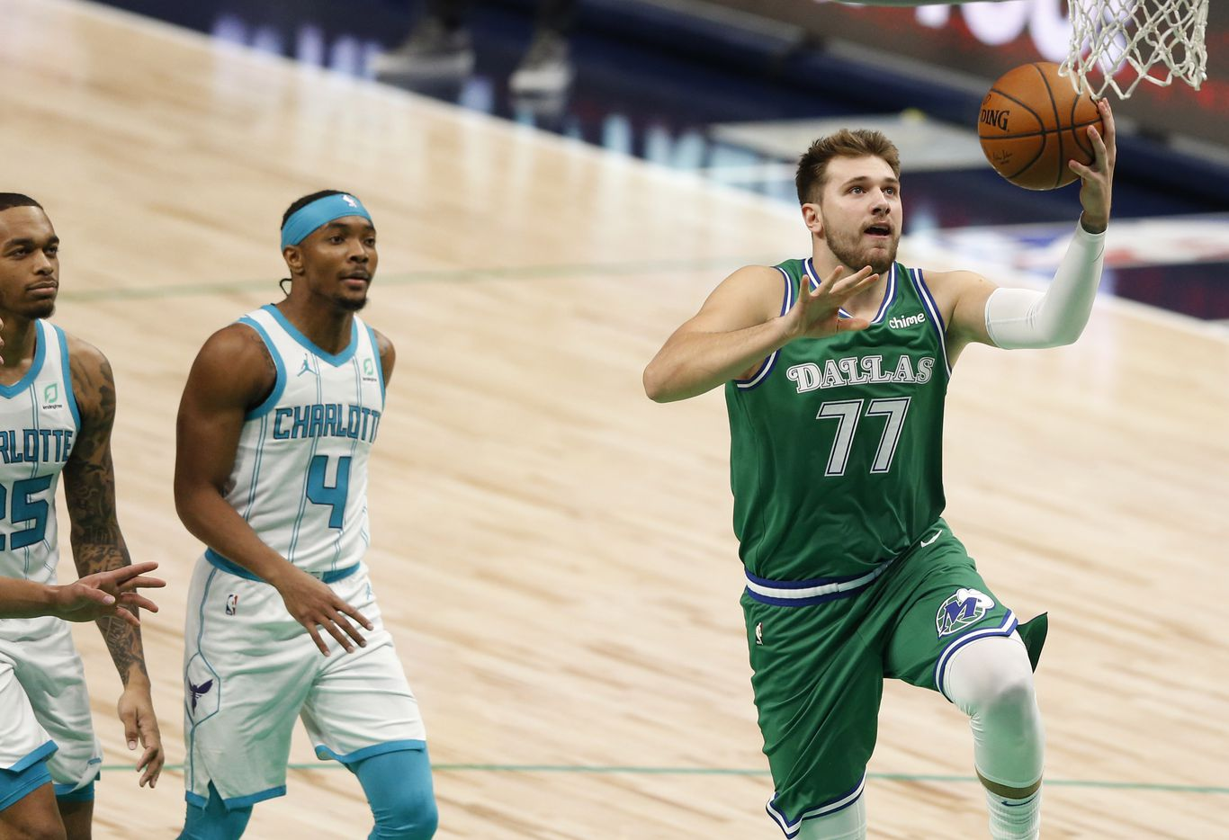 Dallas Mavericks guard Luka Doncic (77) attempts a layup in a game against the Charlotte Hornets during the first quarter of play in the home opener at American Airlines Center on Wednesday, December 30, 2020 in Dallas. (Vernon Bryant/The Dallas Morning News)