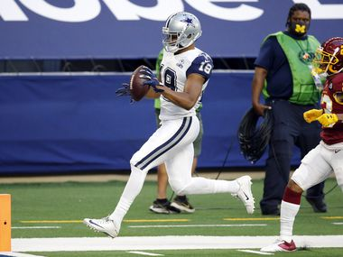Dallas Cowboys wide receiver Amari Cooper (19) scores a second quarter touchdown on a long pass from quarterback Andy Dalton (14) at AT&T Stadium in Arlington, Thursday, November 26, 2020.