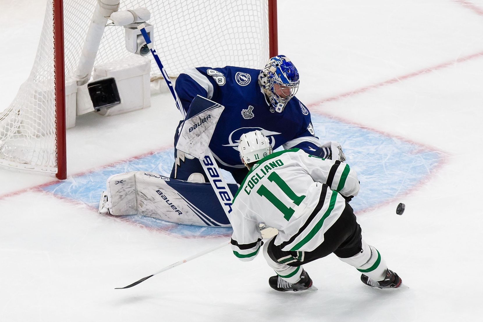 Andrew Cogliano (11) of the Dallas Stars takes a shot on goaltender Andrei Vasilevskiy (88) of the Tampa Bay Lightning during Game Two of the Stanley Cup Final at Rogers Place in Edmonton, Alberta, Canada on Monday, September 21, 2020. (Codie McLachlan/Special Contributor)