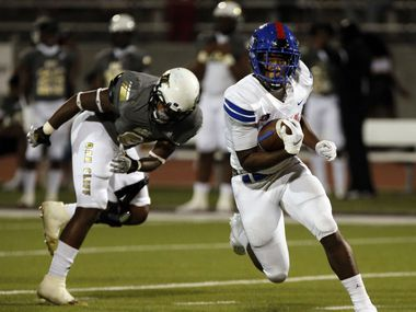 Duncanville's Malachi Medlock (5) eludes South Oak Cliff's Adul Muhammad (6) and gains a couple of yards during the first half of high school football game at Kincaide Stadium in Dallas on Friday, October 3, 2020.