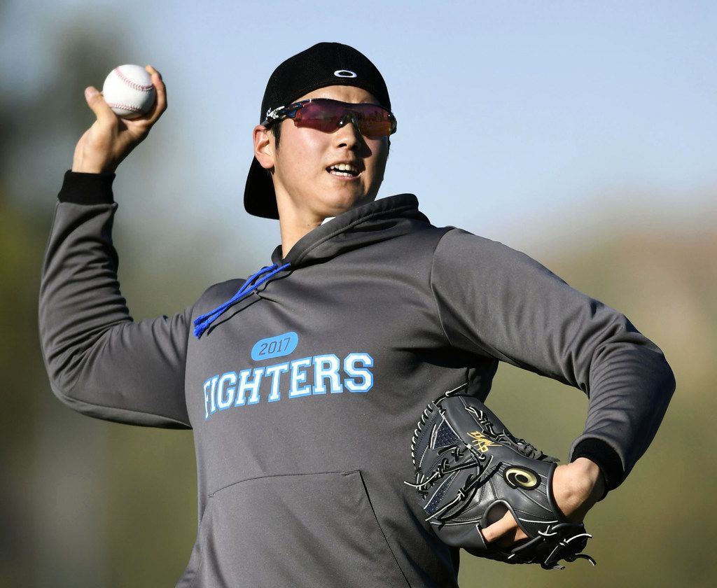 FILE - In this Jan. 31, 2017, file photo, Japanese baseball player Shohei Otani pitches the ball during the Nippon Ham Fighters' spring camp in Peoria, Ariz. Shohei Otani is likely to leave Japan and sign with a Major League Baseball team after this season, multiple reports in Japanese media said Wednesday, Sept. 13, 2017, a move that would cost the 23-year-old pitcher and outfielder more than $100 million. (Junko Ozaki/Kyodo News via AP, File)
