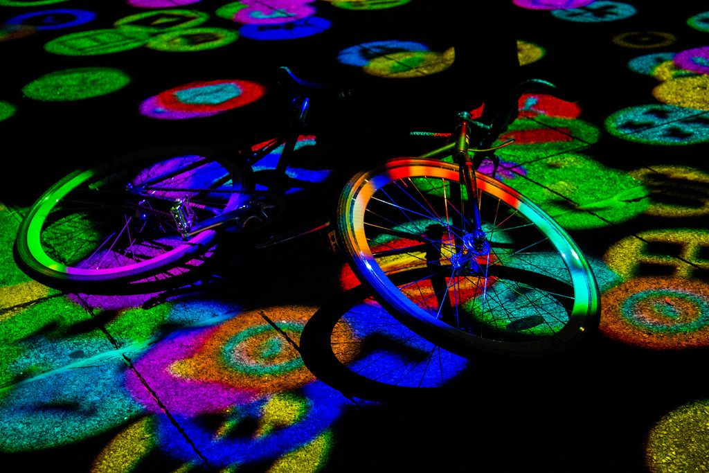 A bike rests while being lit up by Digital Icons by Miguel Chevalier during Aurora in Dallas on Nov. 3, 2018. The free art exhibition focuses on on light, video and sound art.
