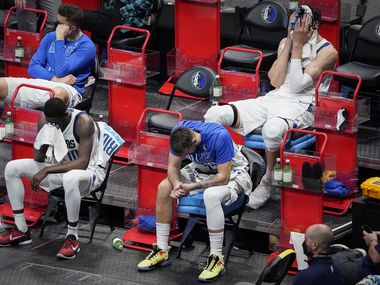 Dallas Mavericks guard Luka Doncic sits (bottom right) on the bench with forward Dorian Finney-Smith (bottom left), forward Maxi Kleber (top left) and center Boban Marjanovic (top right) during the fourth quarter of a loss to the LA Clippers in an NBA playoff basketball game  at American Airlines Center on Sunday, May 30, 2021, in Dallas.