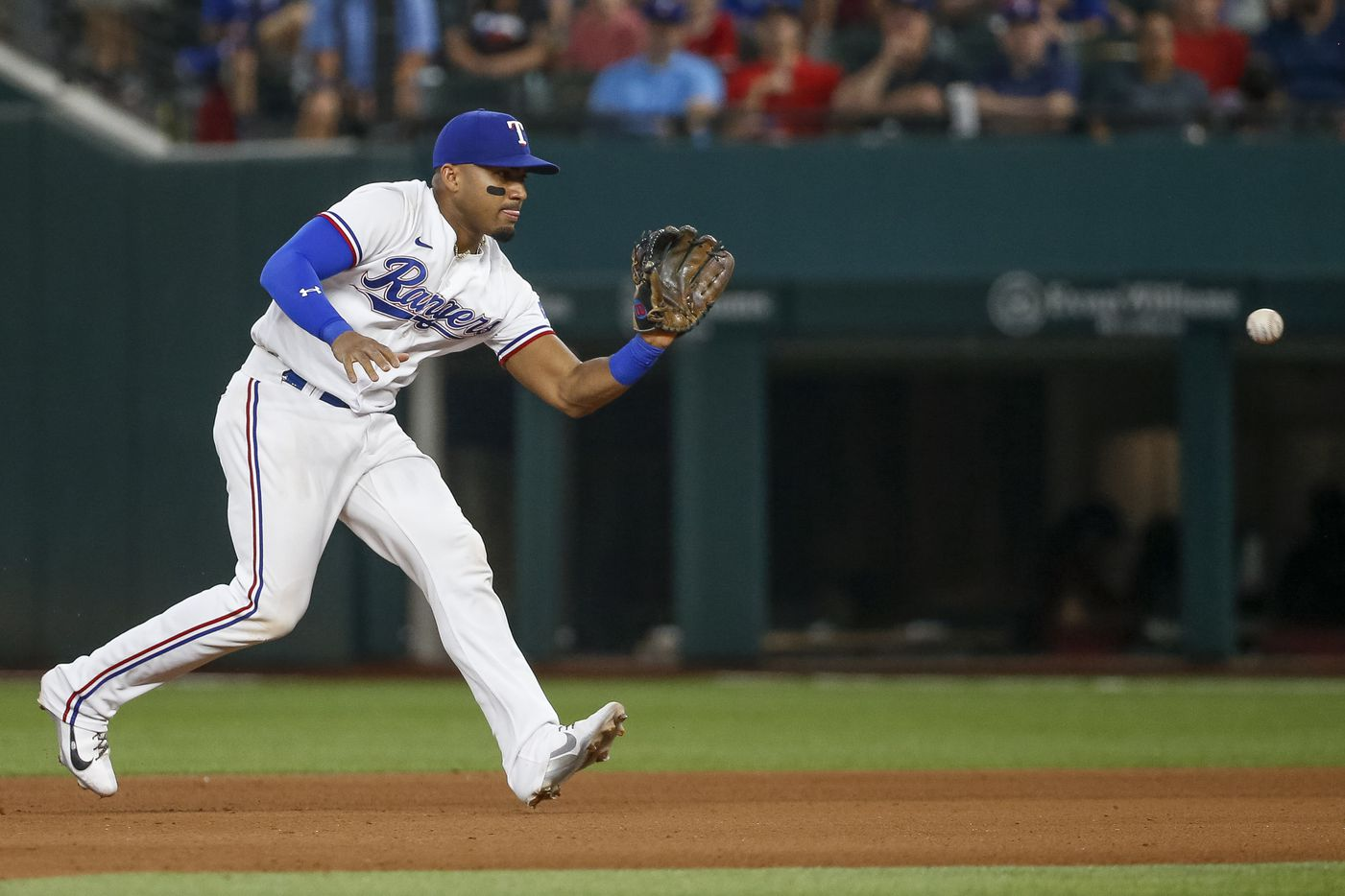 Texas Rangers second baseman Andy Ibanez (77) fields a ball for an out during the fourth inning against the Los Angeles Angels at Globe Life Field on Thursday, Aug. 5, 2021, in Arlington. (Elias Valverde II/The Dallas Morning News)