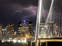 A lightning storm strikes in the backdrop of the skyline in downtown Dallas on Monday night, May 3, 2021. Severe weather warnings were issued throughout the region late Monday night. (Lynda M. González/The Dallas Morning News)