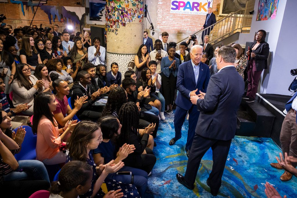 Democratic presidential candidate Joe Biden (facing) shakes hands with Dallas Mayor Mike Rawlings after speaking to participants in the Dallas Mayor's Intern Fellows Program as during a campaign event at SPARK! on Wednesday, May 29, 2019, in Dallas.