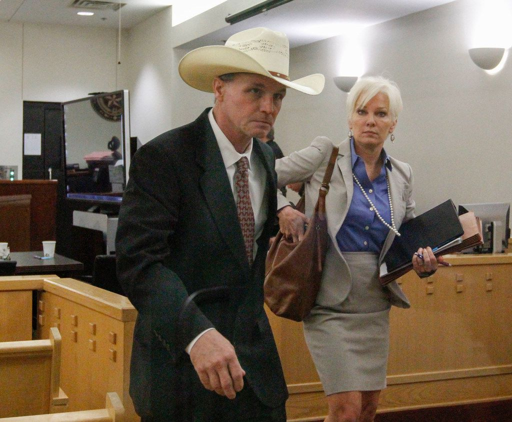 Ken Martin leaves the Tim Curry Criminal Justice Center in Fort Worth, Monday, April 23, 2018 with one of his defense attorneys, former prosecutor Christy Jack, during a break in his trial.