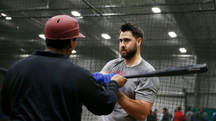 Texas Rangers Joey Gallo (13) works with Texas Rangers hitting coach Luis Ortiz (18) in the batting cage during the Texas Rangers mini camp at Texas Rangers Youth Academy at Mercy Street Sports Complex in Dallas on Tuesday, January 21, 2020.