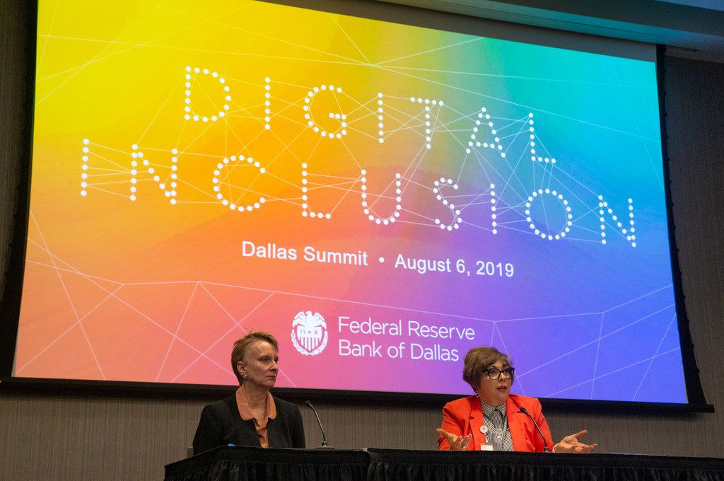 Jordana Barton (right), a senior adviser at the Federal Reserve Bank of Dallas, spoke with Susan Hoff, chief strategy officer for the United Way of Dallas, during a panel Tuesday at the Digital Inclusion Summit at the Federal Reserve Bank of Dallas building in Dallas.