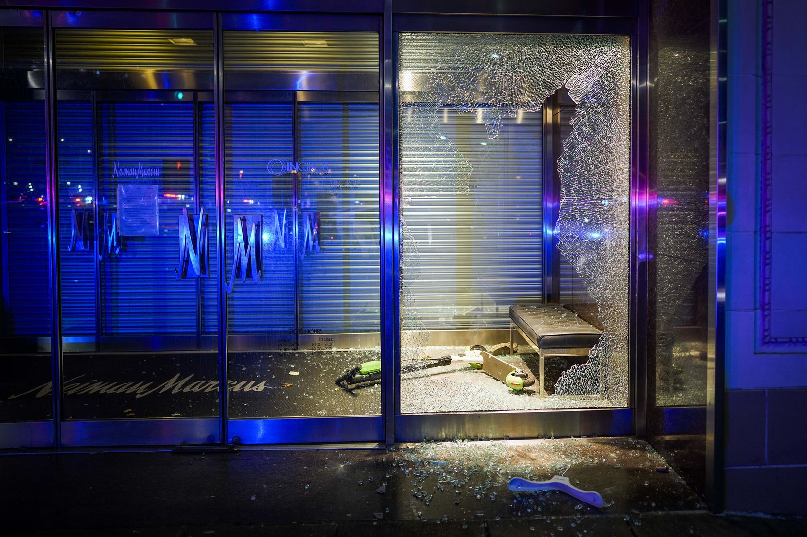 A rental scooter rest amidst broken glass after windows were smashed at the Nieman Marcus store downtown following a protest against police brutality in the early morning hours of Saturday, May 30, 2020, in Dallas.