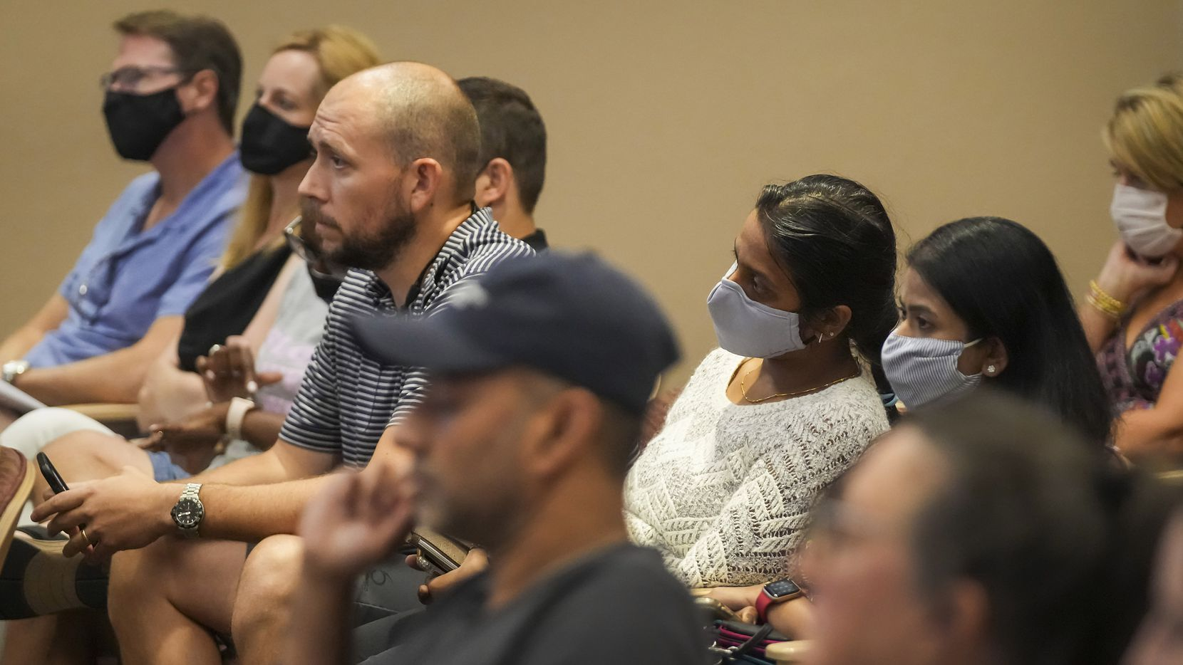 People listen to public comment during the Carroll ISD school board meeting on Monday, Aug. 23, 2021, in Southlake, Texas. (Smiley N. Pool/The Dallas Morning News)