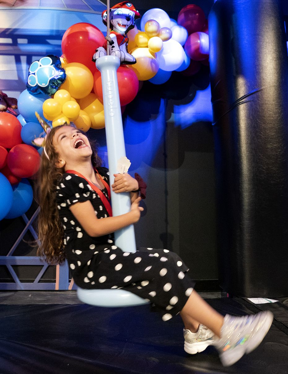 Esther Marques, 4, rides a zip line at 'The Paw Patrol Experience.' It's low to the ground: no harnesses required.