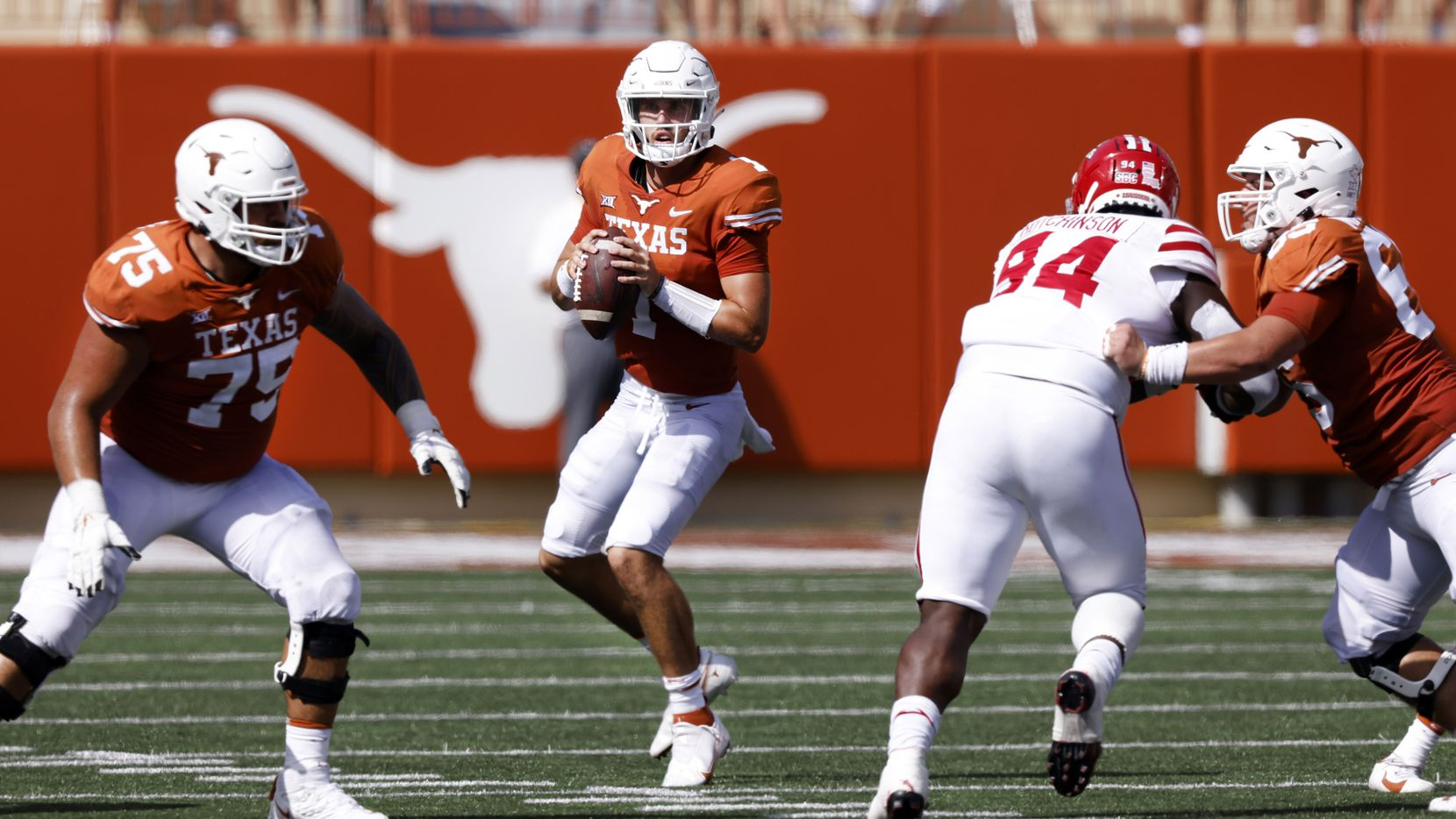 Texas Longhorns quarterback Hudson Card (1) drops back to pass against the Louisiana-Lafayette Ragin Cajuns during the first half at DKR-Texas Memorial Stadium in Austin, Saturday, September 4, 2021.
