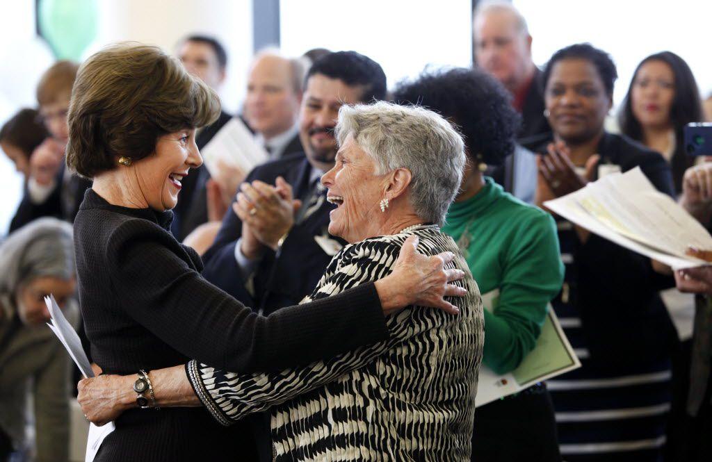 Former first lady Laura Bush hugs Dr. Harryette B. Ehrhardt, former Dallas ISD principal and trustee, and retired state legislator, in 2013.