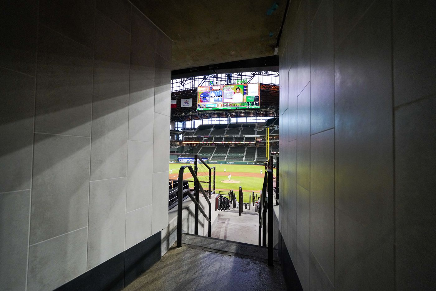 The playing field is sunken below ground level, giving patrons a sweeping view as they enter the seating areas of Globe Life Field from the concourse.