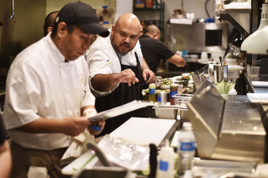 Executive Chef Jose Salmeron instructs his assistants while preparing food at the new restaurant AvoEatery in Dallas.