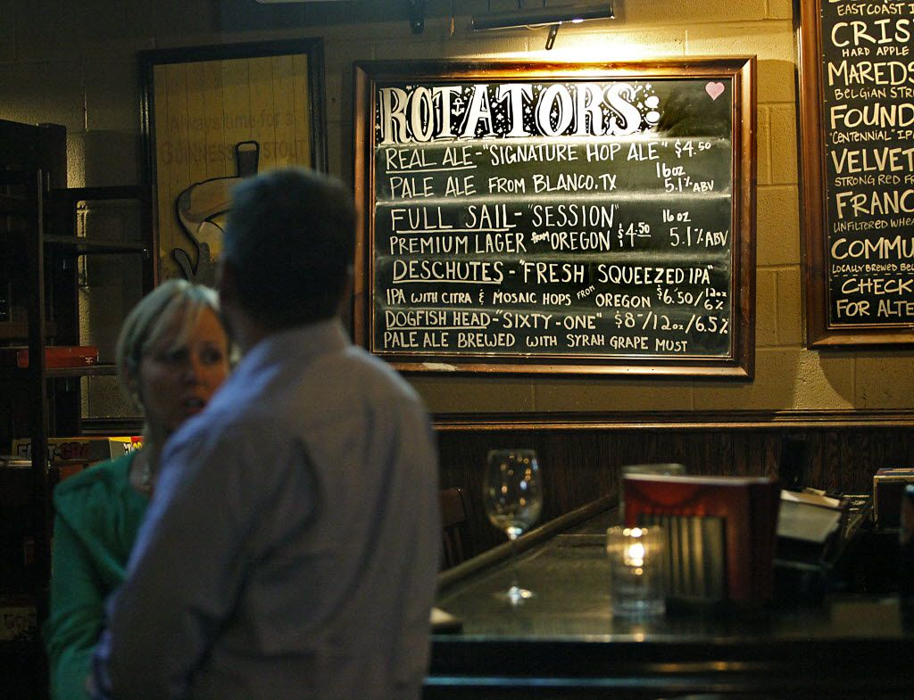 Custom signs advertise some of the beers available at the Fillmore Pub in Plano on Thursday night, September 4, 2014.