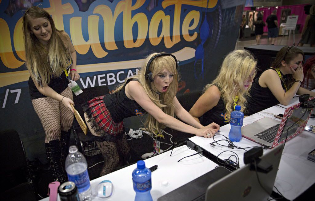 Women perform on live webcams during the Exxxotica Expo 2015 at the Kay Bailey Hutchison Convention Center  in Dallas. The weekend-long event features a wide array of vendors and demonstrations, as well as educational seminars and opportunities to meet adult entertainment stars.