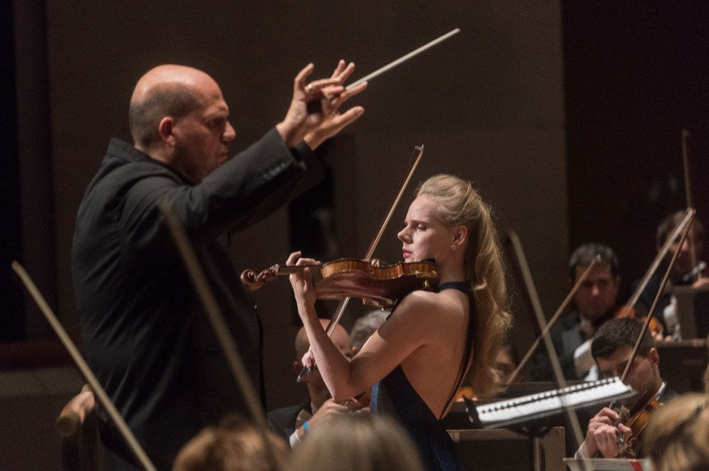 Led by Conductor Jaap Van Sweden, left, Violinist Simone Lamsma performs with the Dallas Symphony Orchestra at the Morton H. Meyerson Symphony Center on Thursday, Sept. 22, 2016.