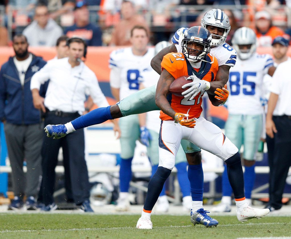 Dallas Cowboys wide receiver Dez Bryant (88) knocks the ball away from Denver Broncos cornerback Aqib Talib (21) on a pass intended for Bryant during the second half of play at Sports Authority Field in Denver on Sunday, September 17, 2017. The Dallas Cowboys lost to the Denver Broncos 42-17. (Vernon Bryant/The Dallas Morning News)