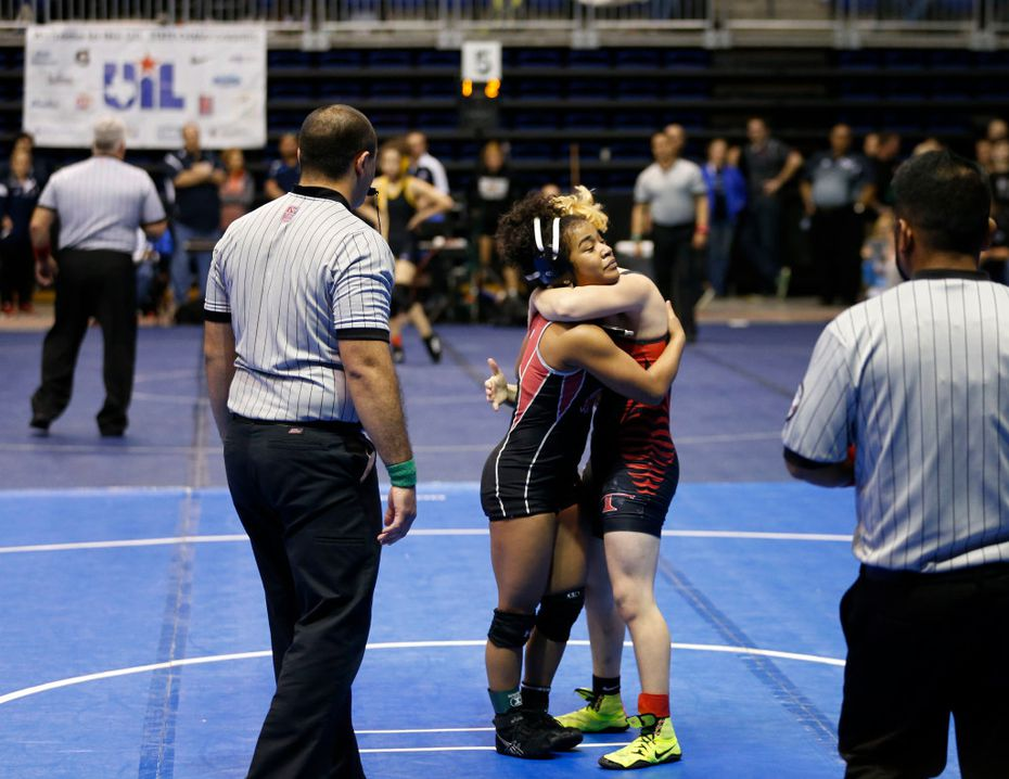 Euless Trinity's Mack Beggs hugs Tascosa's Mya Engert after winning 12-4 in the 6A girls 110 weight class during the UIL Wrestling State Tournament at Berry Center in Cypress on Friday, February 24, 2017. Beggs advances to the semifinal with this victory. (Vernon Bryant/The Dallas Morning News)