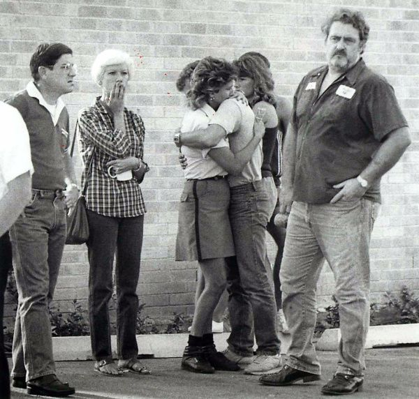 Friends and relatives mourn outside the Edmond, Okla., post office on Aug. 20, 1986. Pat Sherrill, a postal worker who was about to be fired, killed 14 people and wounded six others before killing himself.
