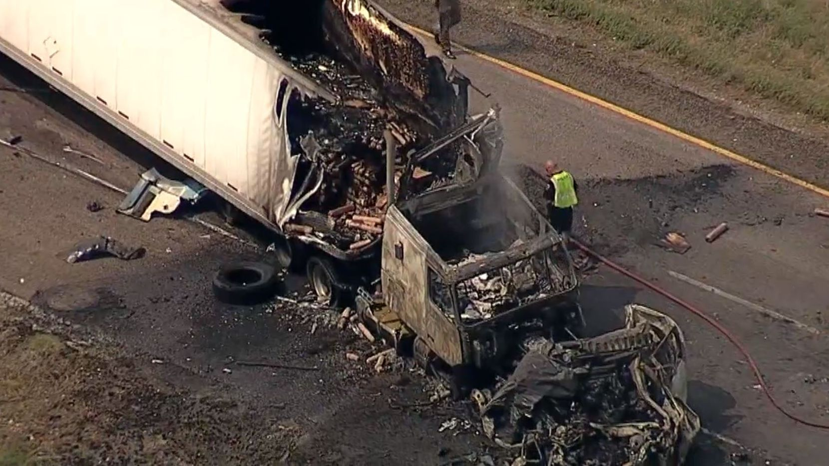 Three people died when an SUV was pinned between two 18-wheelers in Terrell on Tuesday afternoon.