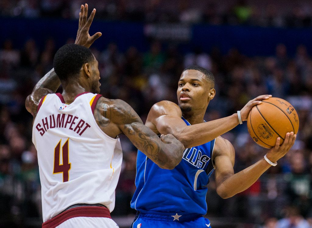 Dallas Mavericks guard Dennis Smith Jr. (1) passes around Cleveland Cavaliers guard Iman Shumpert (4) during the first quarter of an NBA game between the Dallas Mavericks and the Cleveland Cavaliers on Saturday, November 11, 2017 at the American Airlines Center in Dallas. (Ashley Landis/The Dallas Morning News)